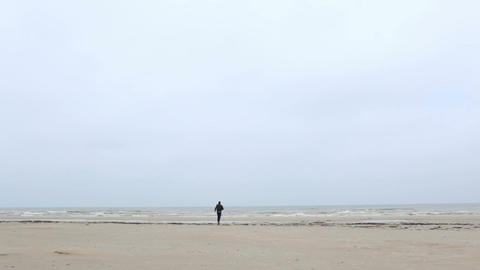 A young man is running to the sea Footage
