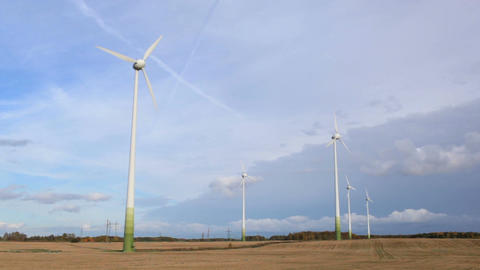 Wind turbines in the field Stock Video Footage