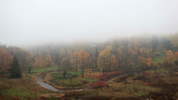 The fog is coming on forest with curving river. Time lapse. Toila, Estonia Footage