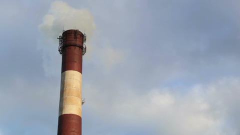Color smoke comes out of the smokestacks at sunset. Air... Stock Video Footage