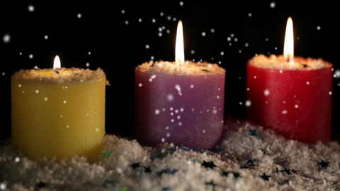 Candles isolated on black. Snow is falling. Holiday... Stock Video Footage