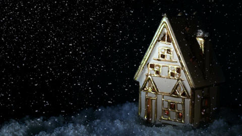 Small house with burning fireplace. It's snowing Stock Video Footage