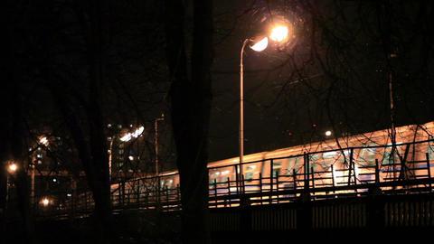 Metro subway train outdoors at night Stock Video Footage