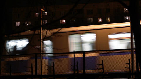 Metro subway train outdoors at night Stock Video Footage