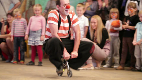 Clown riding a small bike in Akvamarine circus on... Stock Video Footage