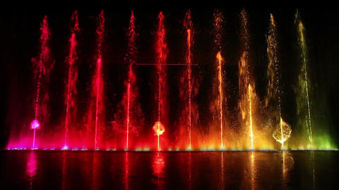 Dancing fountain show with reflection. Wide shot Stock Video Footage
