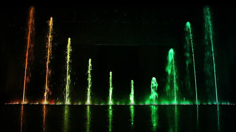 Dancing fountain show with reflection. Wide shot Footage