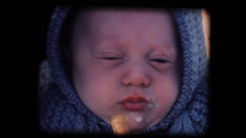 Vintage 8mm. Little baby feeding in his cradle Footage