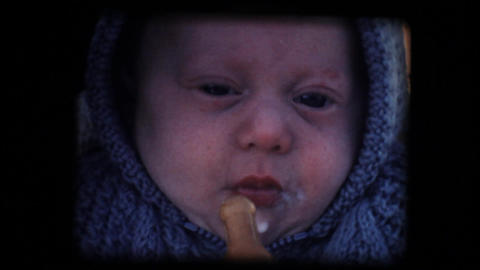 Vintage 8mm. Little baby feeding in his cradle Stock Video Footage