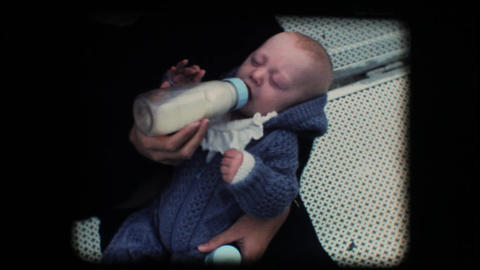 Vintage 8mm. New born baby drinking milk from the Stock Video Footage