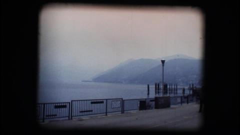 Vintage 8mm. Lakeside walking path Stock Video Footage