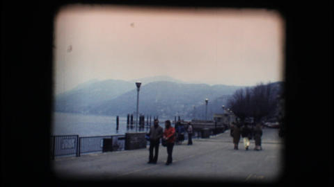 Vintage 8mm. Lakeside walking path Stock Video Footage