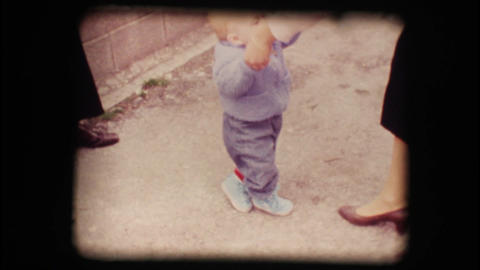 Vintage 8mm. First steps of a child Stock Video Footage