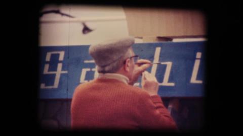 Vintage 8mm. Man painting Stock Video Footage