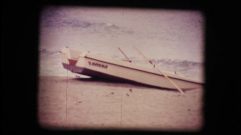 Vintage 8mm. Boat on a empty beach in winter Footage