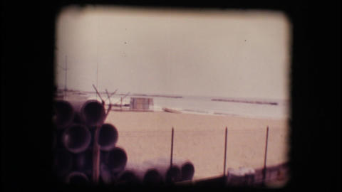 Vintage 8mm. Boat on a empty beach in winter Stock Video Footage