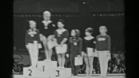 1966: Individual all-around medal podium ceremony women's 16th Artistic Gymnasti Footage