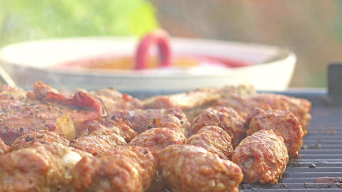 Traditional Romanian Barbecue With Pork Meat Rolls (Mici Or Mititei) And Stakes stock footage