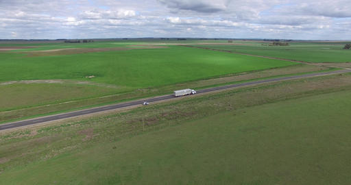 Aerial drone scene of a lonely road at the countryside, capture of a truck going Footage