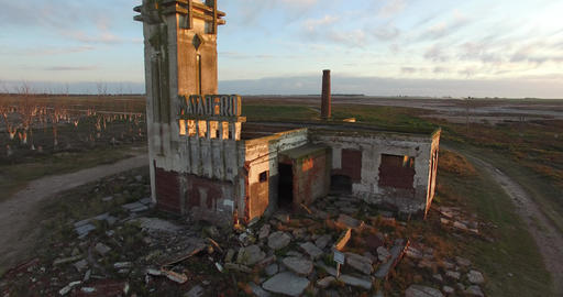 Aerial Drone scene of an abandoned Slaughterhouse at sunset, surrounded by dead  Footage