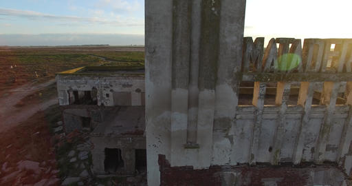 Aerial Drone scene of abandoned Slaughterhouse at sunset, surrounded by dead tre Footage
