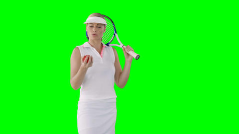 Portrait of woman tennis player is concentrating for a match Live Action