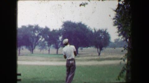 1968: Golfers tee off with iron club on par 3 hole as sweetheart girl watches Footage