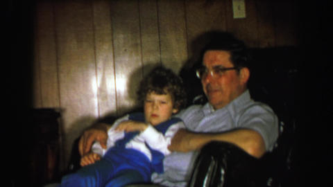 1957: Boy waking up in dad's lap confused as to where he is Footage