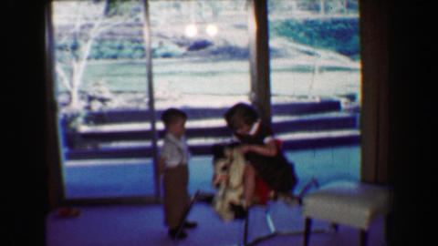1968: Boy girl on toy rocking horse at country clubhouse while dad plays golf Footage
