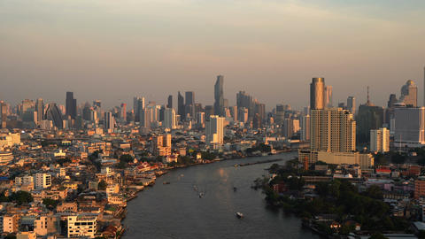 Aerial view of Chao Phraya River, Bangkok Downtown. Thailand. Financial district Live Action