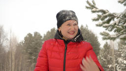 Happy woman in red clothes with snow on her face smiling after falling to snow Footage