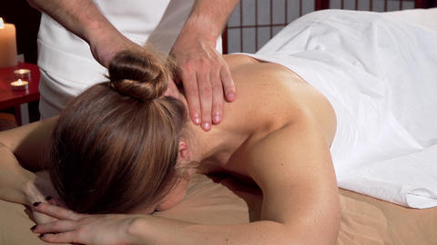 Professional masseur doing relaxing back massage for female client Footage