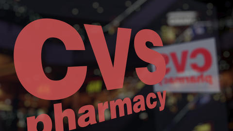 CVS Health logo on the glass against blurred business center. Editorial 3D Footage