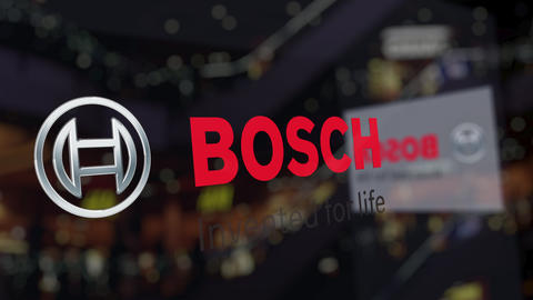 Robert Bosch GmbH logo on the glass against blurred business center. Editorial Live Action