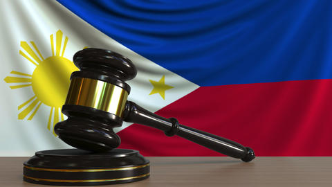 Judge's gavel and block against the flag of the Phippines. Court conceptual Footage