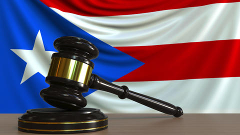 Judge's gavel and block against the flag of the Puerto Rico. Court conceptual Footage