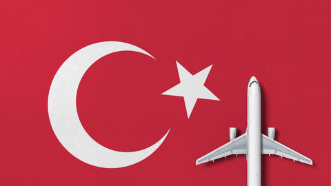 Commercial plane on the flag of Turkey. Tourism related conceptual 3D animation Footage
