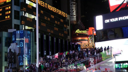 New York 314 Manhattan times square by night; public platform and stock ticker Footage