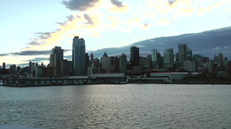 New York 170 Manhattan, Sunrise over Hudson River, Skyline, bright Clouds Footage