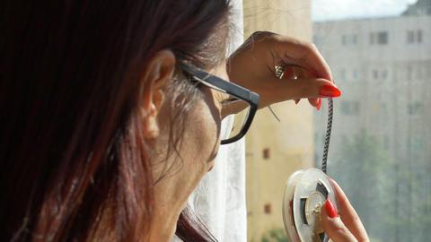 Woman Looking on 8 mm Reel Footage