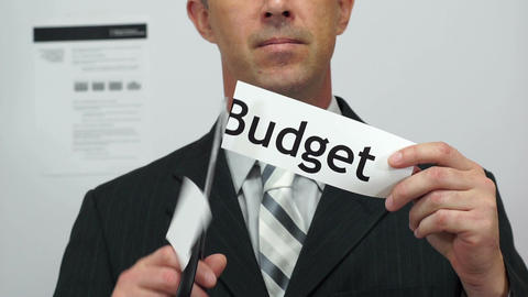 Businessman Cuts Budget Concept Footage