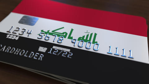 Plastic bank card featuring flag of Iraq. Iraqi national banking system related Footage