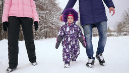 Happy family walking in winter park. A woman with a child on a snowy winter walk Footage