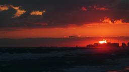 Dark vibrant red sunset in Santa Rosa Beach, Florida gulf of mexico ビデオ
