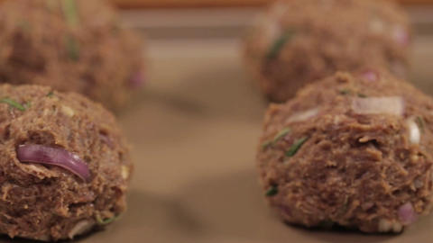 Meat Patty Mixture - Meat Balls On A Tray - Slider - Left To Right Live Action