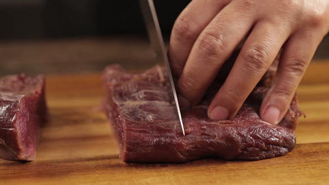 Raw Beef Piece - Being Cut Wth Knife -Front Angle Live Action