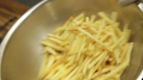 French Fries - Mixing Salt and Shaking French Fries In A... Stock Video Footage