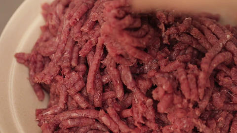 Meat Mincing - Taking Minced Beef Out Of Machine with Hand Live Action