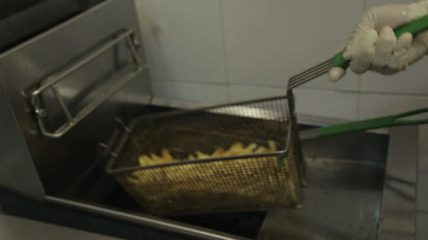 French Fries - Putting Fried French Fries In A Bowl Stock Video Footage