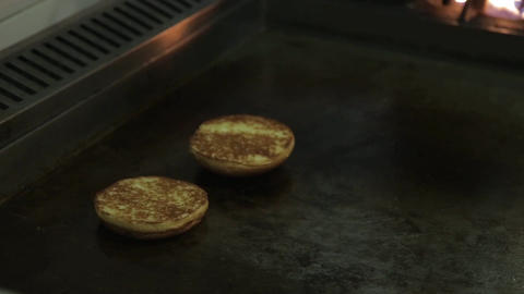 Buns - Flipping Toasted Round Fresh Buns On Griddle -... Stock Video Footage